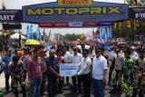 BPJS Ketenagakerjaan Padang beri santunan Rp55,8 juta keluarga pembalap Arif Murizal