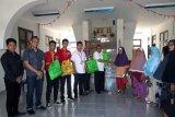 Alfamart-BMCI membagikan sembako untuk warga miskin Boltim
