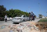 Akibat diserang artileri bandara di ibu kota Libya ditutup