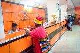 Papua Terkini - Pelayanan Kantor Pos Jayapura kembali normal pascarusuh