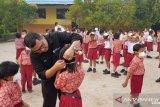 BPJS Ketenagakerjaan bagikan 1.500 masker N95 kepada siswa dan warga Palangka Raya