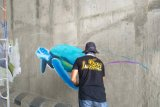 Polisi tangkap satu orang pengeroyok pelukis mural underpass Unila