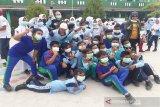 DPRD dan PWI Kotim bagikan 2.000 masker