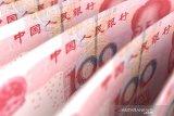 Yuan China berbalik menguat terhadap dolar AS