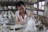 Artikel - Geliat ekonomi Sang Naga
