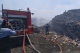 Pemadaman terpadu dengan sistem sambonesia di TPA Antang Makassar