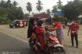 Antisipasi dampak kesehatan, JNE Dharmasraya bagikan masker gratis untuk masyarakat