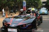 Mobil listrik Lewo Ireng mengaspal di kemacetan Jakarta