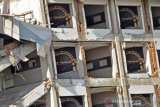 Setahun bencana Sulteng - Gambar Jembatan Kuning terpasang di kamar hotel