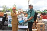 Dinsos Asmat terima bantuan dari komunitas wartawan Merauke