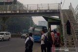 Kota Palembang  masih diselimuti asap akibat titik panas belum habis