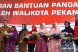 Pekanbaru serahkan BPNT bagi 13.784 keluarga pra sejahtera
