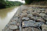 Desa Batumarta OKU bangun bronjong  dan saluran air antisipasi banjir