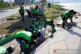 Aksi Bersih Pantai Ojek Daring