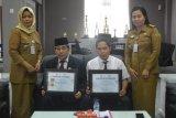 Pemkab Sidrap terima penghargaan TPAKD dari OJK