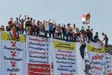 Rakyat Irak turun ke jalan buat protes terbesar sejak kejatuhan Saddam Hussein