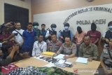 Selain menyebar video rasis, polisi sita senjata api dan seragam loreng dari dua warga Bireuen
