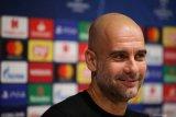 Pep Guardiola masih ingin bertahan di Manchester City