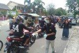 PMI Ogan Komering Ulu bagikan  masker dan bibit pohon