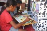 Artikel - Sinergi Polisi-TNI hidupkan budaya membaca anak di pesisir Kupang