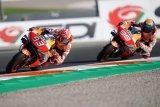 Marquez kawinkan tiga gelar untuk Honda di Valencia, sedangkan Lorenzo pamitan