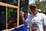 Masuk Pantai Air Manis Padang  kini pakai uang elektronik
