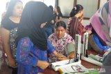 Warga Desa Tanjung  Baru Kabupaten OKU antusias ikuti Program KB gratis