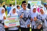 Guru berprestasi di Pesisir Selatan dapat hadiah umrah gratis