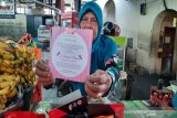 Makanan akikah cucu Jokowi dibagikan ke pedagang dan tukang becak Pasar Gede Solo