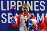 Lifter Lisa Setiawati pejuang tangguh, raih perak SEA Games