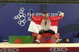 Raihan medali emas lebihi target usai  lifter Rahmat Erwin jadi yang terbaik