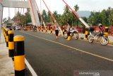 Debit air meningkat, polisi Dharmasraya imbau warga jauhi jembatan kabel stayed