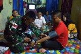 Satgas TNI berikan layanan kesehatan kepada warga di perbatasan RI-Malaysia