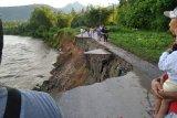 Jalan amblas, Padang Pariaman akan mengalihkan jalan terban di Batang Anai