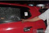 Mobil wartawan Antara dilempari orang  tak dikenal  usai  pemeriksaan di Polda Sulsel