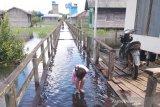 Masyarakat di kawasan rawan banjir mulai waspada