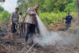 Kapolres bersama tim terpadu turun langsung padamkan api Karhutla di Dusun Sentosa, Inhil