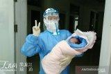 Perempuan terinfeksi corona di China lahirkan bayi sehat