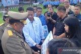 BPJAMSOSTEK-Pemrov Sulawesi Utara serahkan santunan kematian