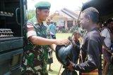 Prajurit TNI bantu DKP Merauke gelar pasar murah di kampung Yanggandur