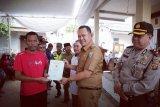 Wabup Pringsewu bagikan sertifikat 524 bidang tanah PTSL di Pekon Waluyo Jati