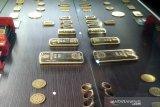Harga emas melonjak usai imbal hasil obligasi turun