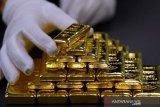 Harga emas berjangka naik tipis, Fed indikasikan akhiri stimulus lebih cepat