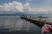 Menyelami Danau Purba dan Gua Tengkorak