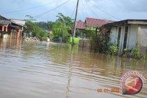 Desa Kelumpang Kabupaten OKU Sumsel diterjang banjir