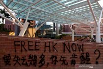 Grafiti demonstran di Hong Kong