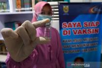 Ajian vaksinasi sedang ditimpakan