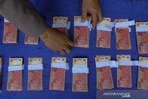Polisi ungkap peredaran uang palsu di PKL Surabaya