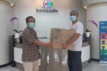 Perangi Covid-19, Indonesia Re bagikan masker gratis