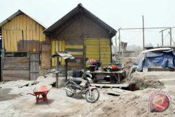 Dampak erupsi Gunung Sinabung, polisi Lhokseumawe bagikan masker